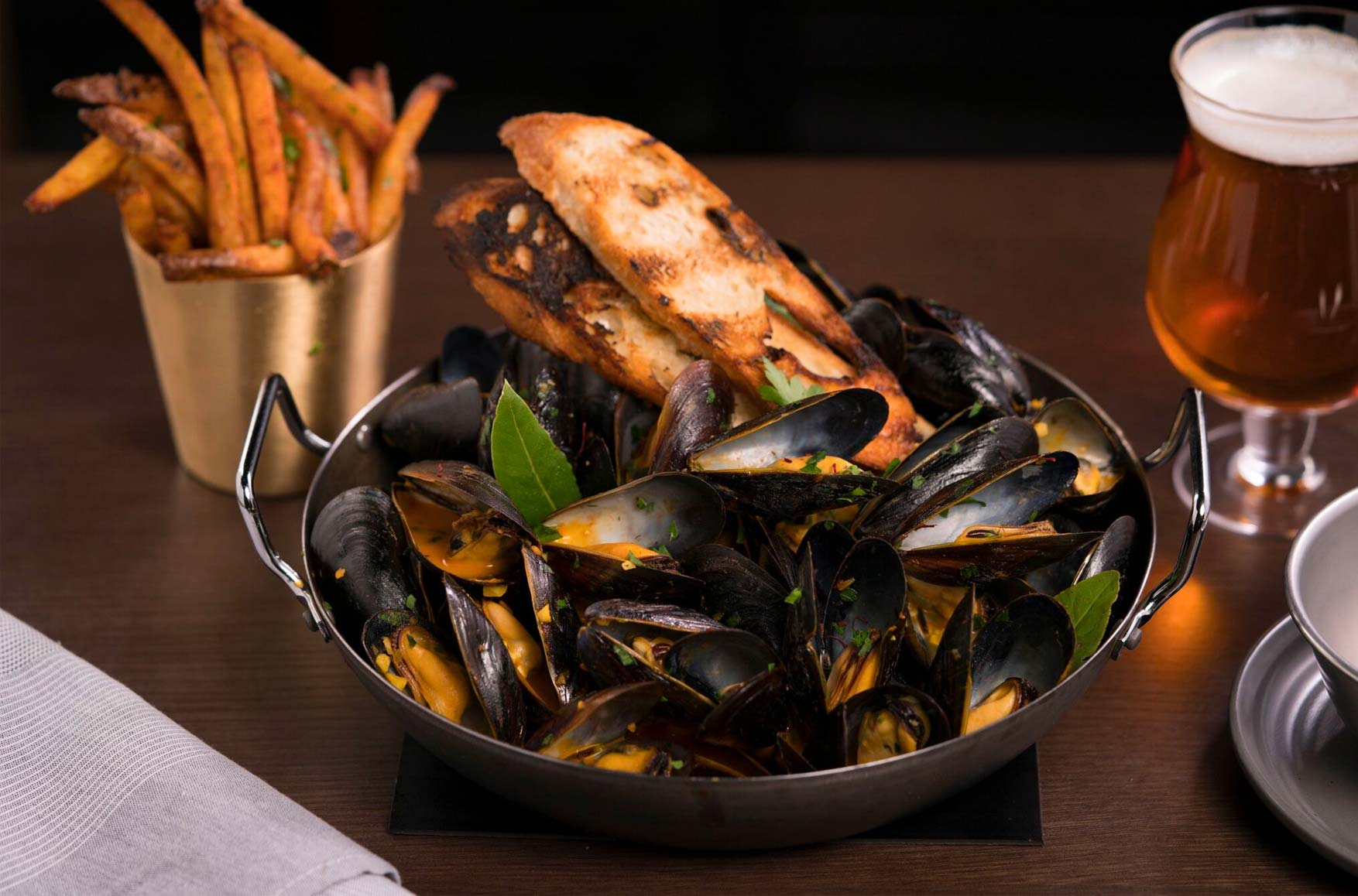 Mussels in silver bowl, French Fries, Beer