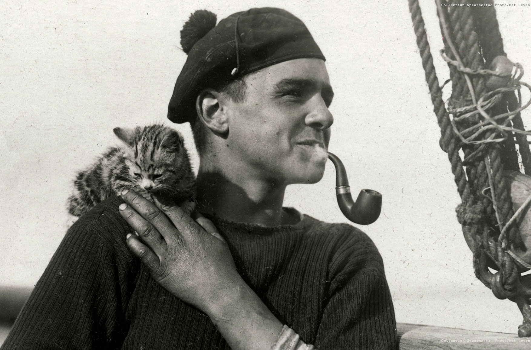 Sailor holding cat smoking pipe